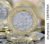One Pound Coins On A Mixture O...