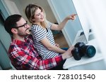 couple working together on... | Shutterstock . vector #728101540
