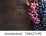 grapes bunch with leaves on a... | Shutterstock . vector #728127190