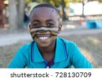 portrait of smiling boy with... | Shutterstock . vector #728130709