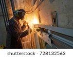 lift worker welding elevator... | Shutterstock . vector #728132563