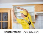 worker installing kitchen... | Shutterstock . vector #728132614
