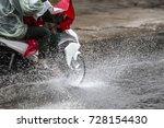 a motorcyclist rides along a... | Shutterstock . vector #728154430