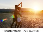 couple dancing salsa on a sandy ... | Shutterstock . vector #728160718