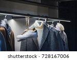 men elegant clothing on hangers ... | Shutterstock . vector #728167006