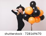 attractive witch dancing with... | Shutterstock . vector #728169670