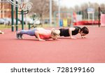 friends doing push ups together | Shutterstock . vector #728199160