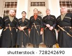 Small photo of Male singers in national Georgian costumes stand on the balcony of the building during a holiday Batumoba in Batumi.Adzharia, Batumi, September 2017