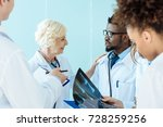 senior doctor talking to... | Shutterstock . vector #728259256
