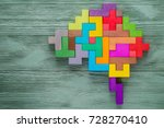 Stock photo human brain is made of multi colored wooden blocks creative business concept 728270410