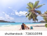 young couple relaxing on exotic ... | Shutterstock . vector #728310598