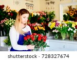 young florist woman making...