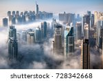 Small photo of Dubai skyline, an impressive aerial top view of the city in Dubai Marina on a foggy day