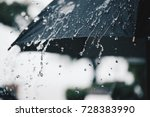 back umbrella in the rain in... | Shutterstock . vector #728383990