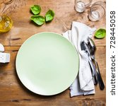 Small photo of empty plate on table