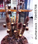 Candlestick With Pine Cones An...