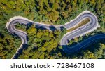 curved road trough the forest.... | Shutterstock . vector #728467108