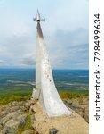 Small photo of Stella rocket on a rock in honor of Gagarin's flight. Established in 1961 on mountain Kachkanar. Sverdlovsk region. The Urals. Russia