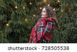 young woman in a plaid against...   Shutterstock . vector #728505538