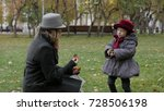 mom and daughter in the park...   Shutterstock . vector #728506198