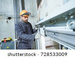 machinist with spanner... | Shutterstock . vector #728533009