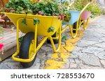 Wheelbarrows With Flowers In...