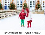 kids ice skating in winter park ... | Shutterstock . vector #728577580