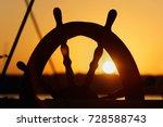Ship's Wheel On Sunset...