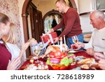 dad giving a red gift to little ... | Shutterstock . vector #728618989