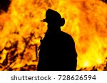 firefighter with flames in the... | Shutterstock . vector #728626594