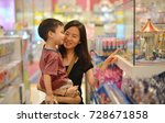 young asian mother and her kid... | Shutterstock . vector #728671858