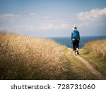 man walking on camino de... | Shutterstock . vector #728731060