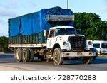 Small photo of QUINTANA ROO, MEXICO - MAY 16, 2017: Aged flat-bed truck Dina D-531 at the interurban road.