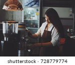 asian woman working in coffee... | Shutterstock . vector #728779774