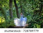 brunette in a flying white... | Shutterstock . vector #728789779