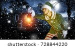 xmas time and elf with lamp  | Shutterstock . vector #728844220