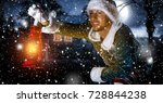 xmas time and elf with lamp  | Shutterstock . vector #728844238
