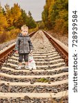 sad little boy alone on rails... | Shutterstock . vector #728939584