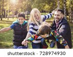 family fun.mixed race person in ... | Shutterstock . vector #728974930