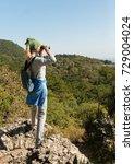 a blond woman tourist looking... | Shutterstock . vector #729004024