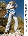 a blond woman tourist with... | Shutterstock . vector #729004030