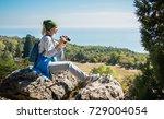 a blond woman tourist with... | Shutterstock . vector #729004054
