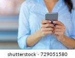 businesswoman using smartphone   | Shutterstock . vector #729051580