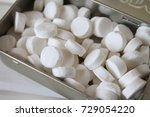 Small photo of Breath mints in a tin can Isolated on white background