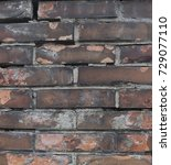 Small photo of Texture of briquette wall red brown black