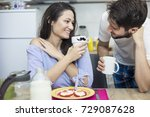 happy mornings.young couple in... | Shutterstock . vector #729087628