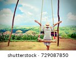 the female tourists sit swing... | Shutterstock . vector #729087850