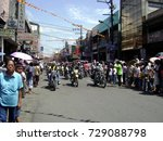 Small photo of DAVAO CITY, PHILIPPINES—CIRCA AUGUST 2014: Men in motorcycles pave the way for a parade about to pass through at the San Pedro Street in Davao City, Philippines.