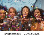 Young Women Blowing Confetti...