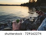 Small photo of some people chill together on the shore and drink beer